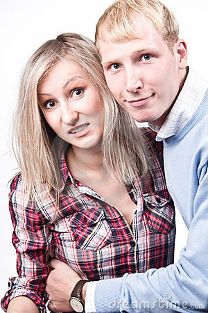 A young loving couple, on gray gradient background
