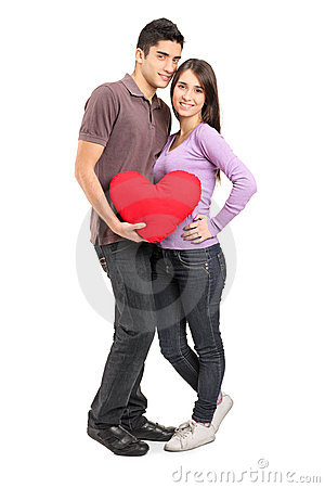 Young loving couple holding a pillow