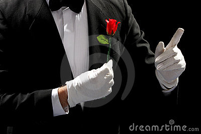 Young magician performing red rose