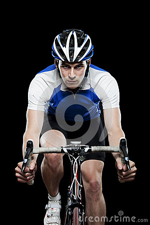 Young male cyclist on bike