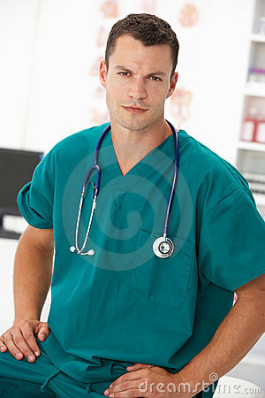 Young male doctor in consulting room