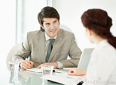 Young male executive taking an interview