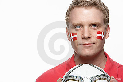 Young Male Football Fan With Danish Flag Painted O