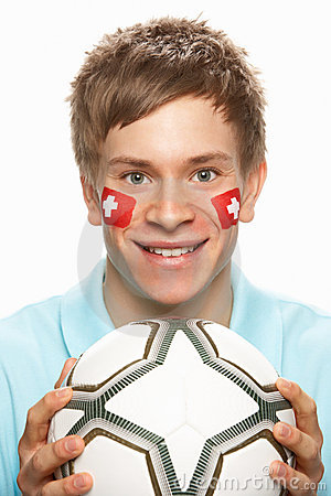 Young Male Football Fan With Swiss Flag Painted On
