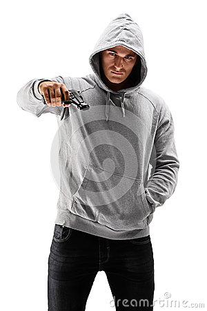 Young male with hood over his head holding a gun, symbolizing cr