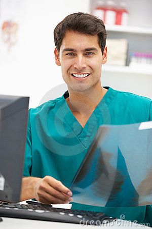 Young male hospital doctor at desk