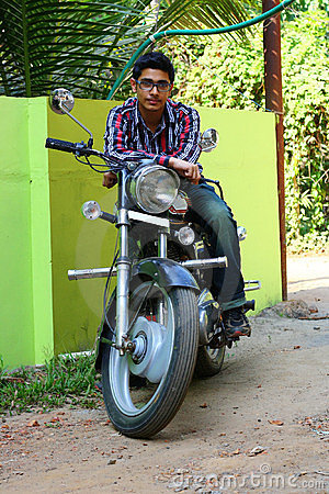 Young Male Indian on a Big Black Bike