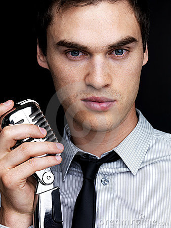 Young male jazz singer with a old microphone
