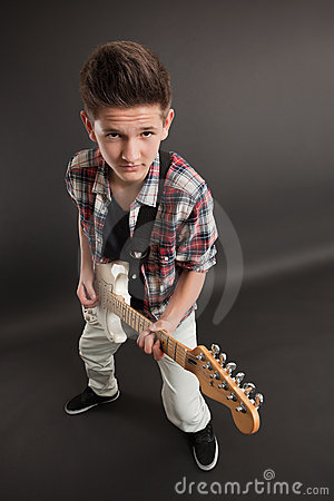 Young male posing with a guitar