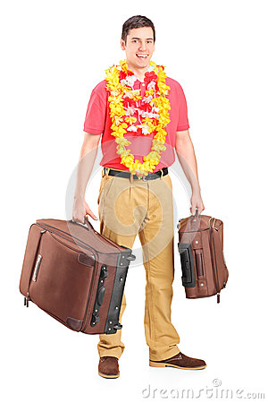 Young male prepared for departure, posing with his luggage