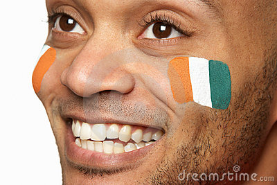 Young Male Sports Fan With Ivory Coast Flag Painte