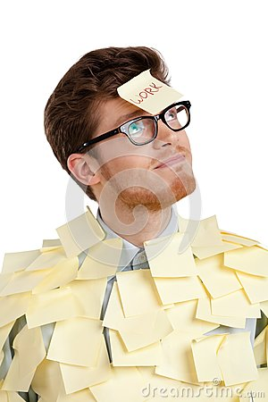 Young male with a sticky note on his face, covered with yellow stickers