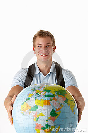 Young male traveller with globe
