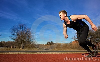 Young man accelerating into sprint