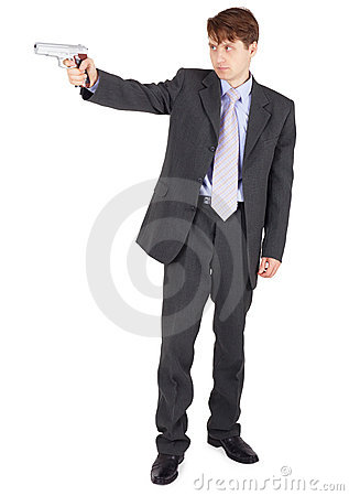 Young man aiming a firearm on white background