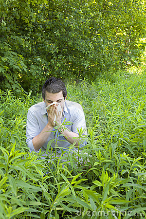Young Man with Allergies in Field