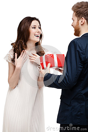 Young man amazes his girlfriend with present