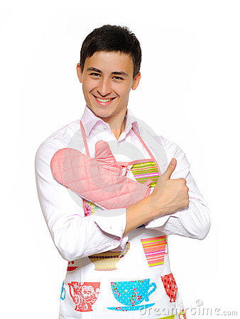 Young man in apron preparing to cook