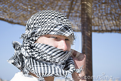 Young man with arab scarf in face