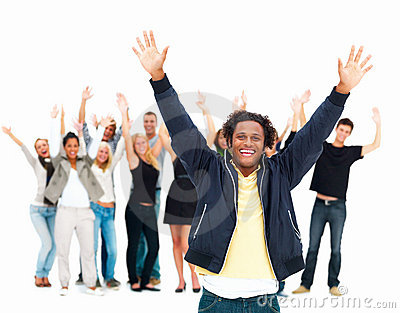 Young man with arms in air celebrateing success