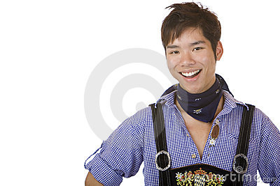 Young man in Bavarian Oktoberfest leather trousers