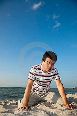 Young man by the beach