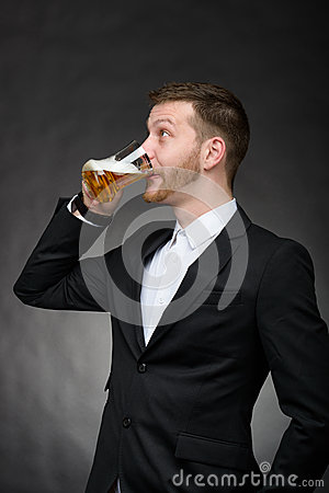 Young man with beard drinking beer
