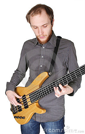 Young man with beard playing bass guitar
