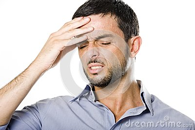 Young Man with Beard suffering Headache