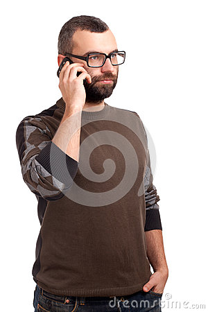 Young man with beard using cell phone