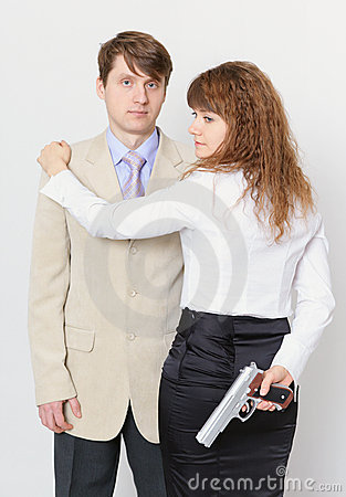 Young man and beautiful woman with gun in hand