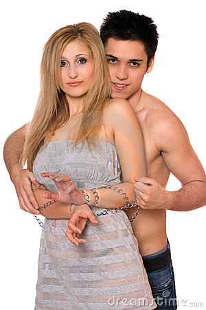 Young man and blonde in chains