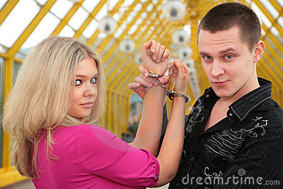 Young man and blonde in handcuff