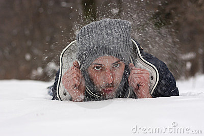 Young man blowing snow