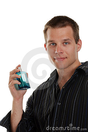 Young man with a blue cologne bottle Stock Photo