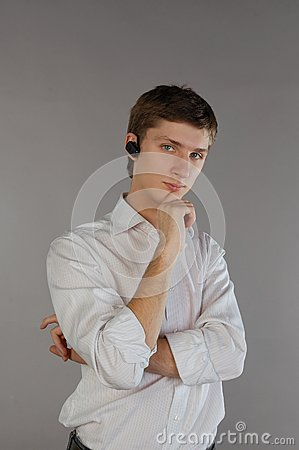 Young man with a bluetooth headset
