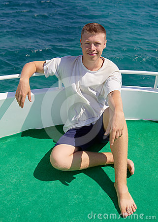Young man on a board yacht