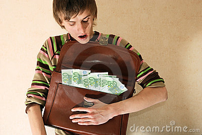 Young man with briefcase full of money