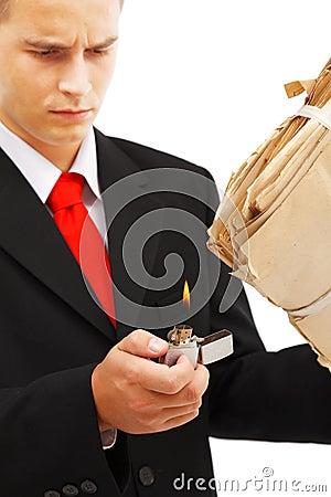 Young man burning file folder