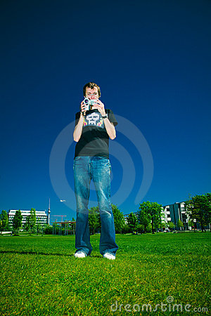 Young man with camcorder