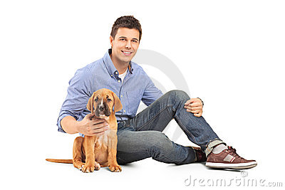 Young man with a cane corso puppy