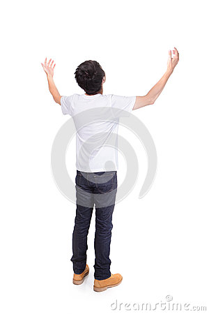 Young man carefree outstretched arms