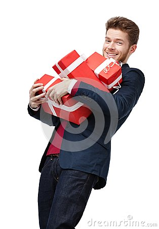 Young man carries a lot of heavy presents