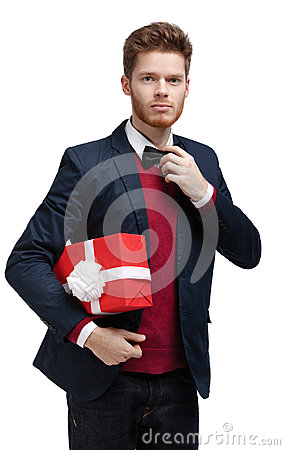 Young man  carries a present to someone