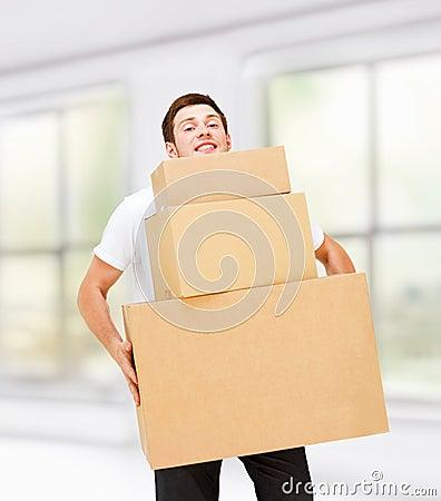 Young man carrying carton boxes