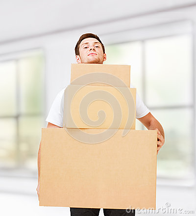Young man carrying carton boxes