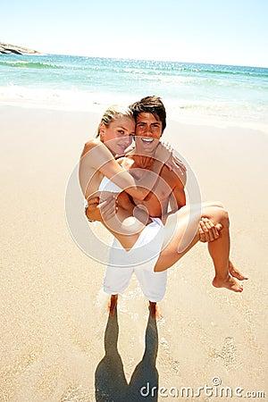 Young man carrying his cute girlfriend