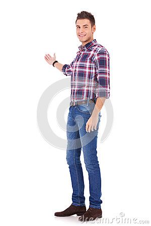 Young man in casual clothes presenting