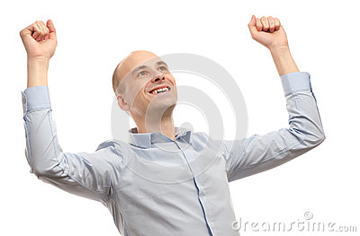 Young man celebrating success with raised hand