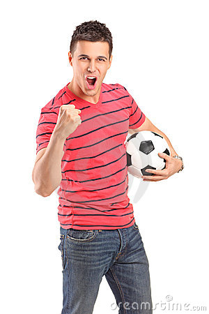 Young man cheering and holding a football